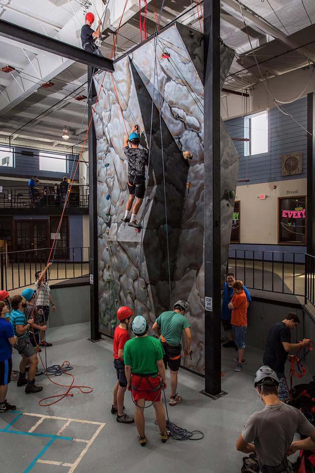 Teen boys climbing the Calo rockwall