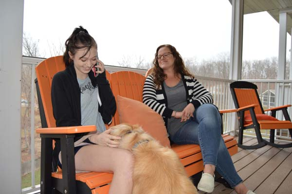 Teen girl with dog and counselor