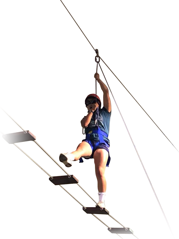 Teen girl on rope course